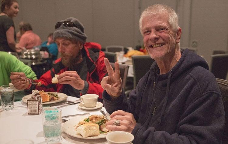 homeless man eating thanksgiving meal